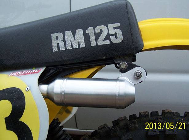 Silencer on bike, view in pits.